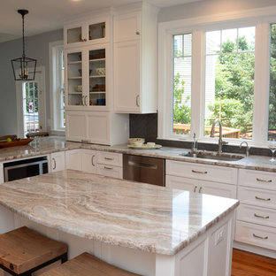 This is an example of a large transitional l-shaped separate kitchen in DC Metro with an undermount sink, recessed-panel cabinets, white cabinets, granite benchtops, black splashback, stainless steel appliances, light hardwood floors, with island, brown floor and beige benchtop.