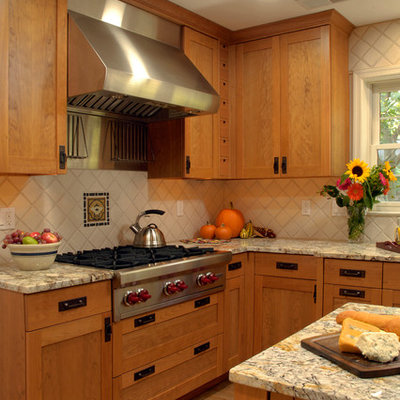 Example of a mid-sized arts and crafts u-shaped light wood floor eat-in kitchen design in DC Metro with an undermount sink, glass-front cabinets, medium tone wood cabinets, granite countertops, multicolored backsplash, mosaic tile backsplash, stainless steel appliances and an island