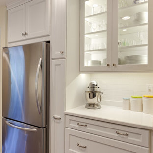 Mid-sized transitional eat-in kitchen photos - Mid-sized transitional galley medium tone wood floor eat-in kitchen photo in Atlanta with a single-bowl sink, recessed-panel cabinets, white cabinets, quartz countertops, white backsplash, stainless steel appliances and no island