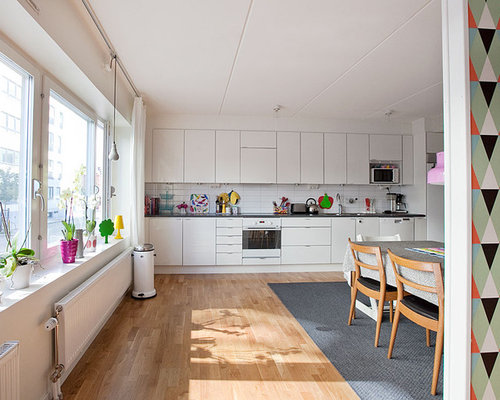 Inspiration for a mid-sized scandinavian single-wall medium tone wood floor  eat-