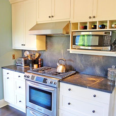 Traditional Kitchen by MICHAEL HOMCHICK STONEWORKS