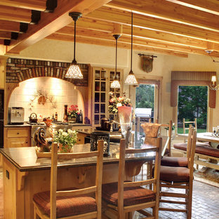 Inspiration for a mid-sized eclectic l-shaped eat-in kitchen in Los Angeles with raised-panel cabinets, light wood cabinets, granite benchtops, ceramic splashback and brick floors.