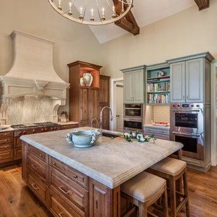 Huge traditional enclosed kitchen remodeling - Inspiration for a huge timeless medium tone wood floor enclosed kitchen remodel in Other with an undermount sink, raised-panel cabinets, medium tone wood cabinets, quartzite countertops, porcelain backsplash, an island, gray backsplash, stainless steel appliances and gray countertops