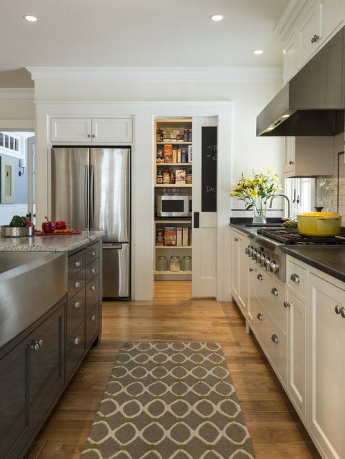 example of a large classic galley medium tone wood floor kitchen design in portland maine with - Top Home Design