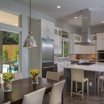 Trendy eat-in kitchen photo in Austin with matchstick tile backsplash, stainless steel appliances, multicolored backsplash and white cabinets