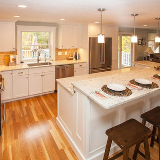 Large traditional eat-in kitchen designs - Eat-in kitchen - large traditional l-shaped light wood floor and brown floor eat-in kitchen idea in Boston with an undermount sink, flat-panel cabinets, white cabinets, quartz countertops, brown backsplash, ceramic backsplash, stainless steel appliances and an island