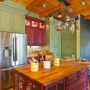 Elegant kitchen photo in Phoenix with green cabinets