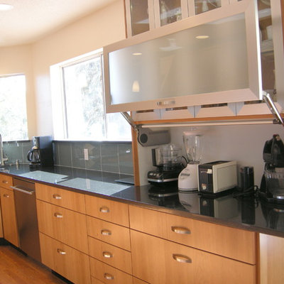 Example of a large transitional dark wood floor eat-in kitchen design in Albuquerque with an undermount sink, flat-panel cabinets, medium tone wood cabinets, quartz countertops, green backsplash, glass tile backsplash, stainless steel appliances and no island
