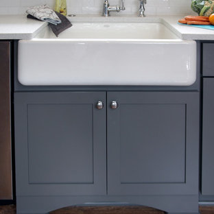 Mid-sized transitional eat-in kitchen ideas - Eat-in kitchen - mid-sized transitional u-shaped dark wood floor and brown floor eat-in kitchen idea in Milwaukee with a farmhouse sink, shaker cabinets, gray cabinets, white backsplash, subway tile backsplash, stainless steel appliances, a peninsula, quartzite countertops and gray countertops