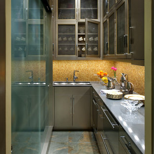 This is an example of a small contemporary l-shaped kitchen pantry in Dallas with a submerged sink, flat-panel cabinets, grey cabinets, composite countertops, yellow splashback, mosaic tiled splashback, stainless steel appliances, slate flooring and no island.