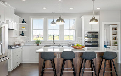 4 Kitchens With White Cabinets and a Wood Island
