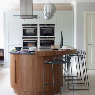 Inspiration for a contemporary kitchen remodel in London with shaker cabinets, blue cabinets, an island and granite countertops