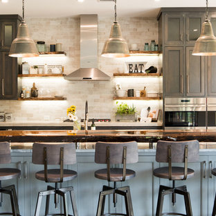 Eat-in kitchen - large rustic l-shaped dark wood floor and brown floor eat-in kitchen idea in Charleston with a farmhouse sink, shaker cabinets, dark wood cabinets, quartzite countertops, gray backsplash, stone tile backsplash, stainless steel appliances and an island