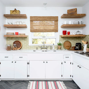 Inspiration for a small country l-shaped kitchen in Raleigh with a double-bowl sink, green splashback, no island and white cabinets.