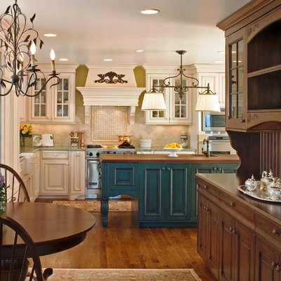 Kitchen - traditional kitchen idea in San Diego with wood countertops