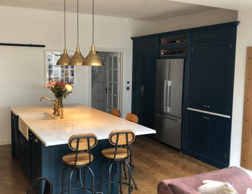 Stunning classic dark blue kitchen with a cafe style feel