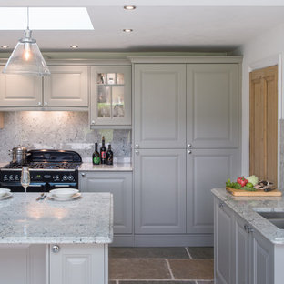 Medium sized rural u-shaped open plan kitchen in Cornwall with a built-in sink, shaker cabinets, grey cabinets, granite worktops, multi-coloured splashback, black appliances, slate flooring, an island, beige floors and multicoloured worktops.