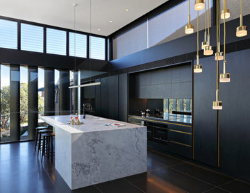 Stunning Dark Veneer and Marble kitchen