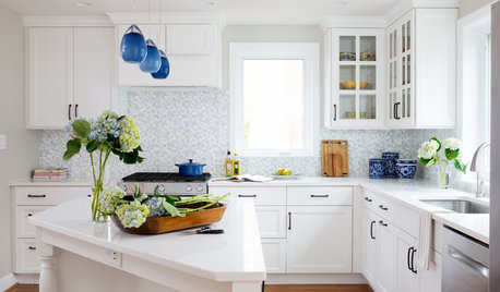 white cabinets and blue accents brighten a kitchen - White Kitchens