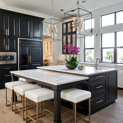 Large elegant light wood floor kitchen photo in Austin with black cabinets, quartz countertops, marble backsplash, stainless steel appliances, an island, white countertops and raised-panel cabinets