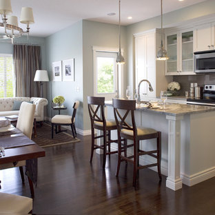 Example of a classic open concept kitchen design in Calgary with gray backsplash, glass sheet backsplash and white cabinets