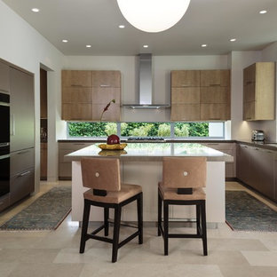 Enclosed kitchen - mid-sized modern travertine floor and beige floor enclosed kitchen idea in Miami with an undermount sink, flat-panel cabinets, quartz countertops, paneled appliances, an island, brown cabinets and window backsplash