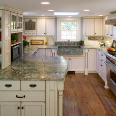Farmhouse Kitchen by Out of the Woods Construction & Cabinetry, Inc.