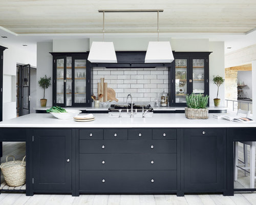 Classic Kitchen In London With Glass Front Cabinets, White Splashback,  Metro Tiled Splashback