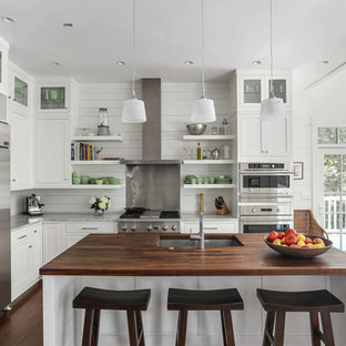 Example of a coastal l-shaped eat-in kitchen design in Charleston with a single-bowl sink, shaker cabinets, white cabinets, wood countertops and stainless steel appliances