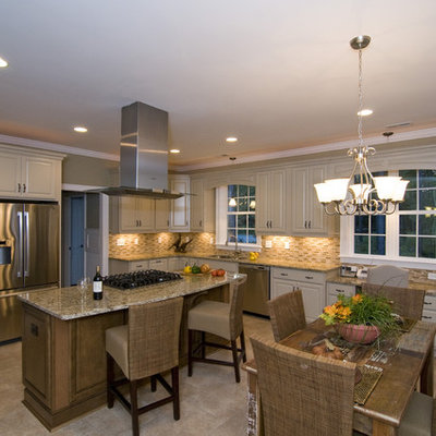 Elegant eat-in kitchen photo in Raleigh with stainless steel appliances and beige backsplash