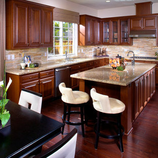 Large transitional open concept kitchen photos - Large transitional l-shaped dark wood floor open concept kitchen photo in San Francisco with an undermount sink, raised-panel cabinets, white cabinets, granite countertops, beige backsplash, stainless steel appliances and an island