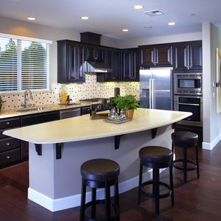 Large transitional open concept kitchen designs - Large transitional l-shaped dark wood floor open concept kitchen photo in San Francisco with an undermount sink, shaker cabinets, dark wood cabinets, granite countertops, mosaic tile backsplash, stainless steel appliances and an island