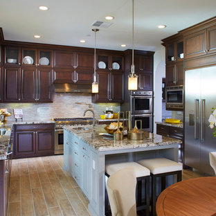 Large transitional eat-in kitchen designs - Eat-in kitchen - large transitional u-shaped eat-in kitchen idea in San Francisco with an undermount sink, raised-panel cabinets, dark wood cabinets, granite countertops, beige backsplash, mosaic tile backsplash, stainless steel appliances and an island