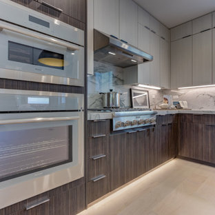 Open concept kitchen photos - L-shaped open concept kitchen photo in San Francisco with shaker cabinets, stainless steel appliances, an island and an undermount sink