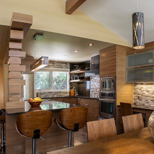 Contemporary kitchen designs - Kitchen - contemporary cork floor kitchen idea in Other with an undermount sink, medium tone wood cabinets, glass countertops, beige backsplash, glass tile backsplash, stainless steel appliances and an island