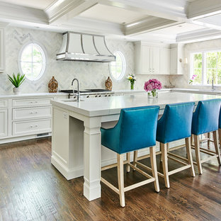 Large transitional u-shaped eat-in kitchen in New York with with island, an undermount sink, beaded inset cabinets, white cabinets, quartz benchtops, panelled appliances, medium hardwood floors and pink floor.