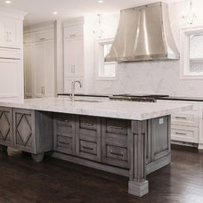 Transitional Kitchen by Summit Signature Homes, Inc.