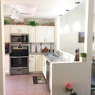 Small transitional l-shaped kitchen pantry in Las Vegas with a double-bowl sink, beaded inset cabinets, white cabinets, quartz benchtops, white splashback, porcelain splashback, stainless steel appliances, porcelain floors, no island and pink floor.