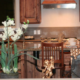 Photo of a large arts and crafts u-shaped open plan kitchen in Salt Lake City with an undermount sink, raised-panel cabinets, light wood cabinets, granite benchtops, green splashback, slate splashback, stainless steel appliances, dark hardwood floors, with island, brown floor and green benchtop.