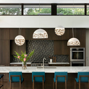 Contemporary kitchen appliance - Inspiration for a contemporary galley dark wood floor and brown floor kitchen remodel in Minneapolis with an undermount sink, flat-panel cabinets, dark wood cabinets, gray backsplash, stainless steel appliances, an island and white countertops