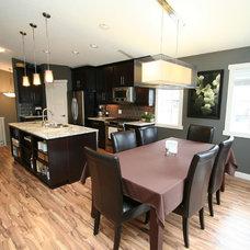 Contemporary Kitchen by Rivet Management Ltd
