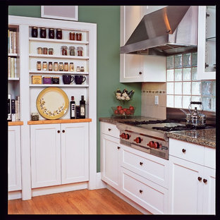 Mid-sized craftsman eat-in kitchen appliance - Mid-sized arts and crafts galley medium tone wood floor eat-in kitchen photo in San Francisco with an undermount sink, shaker cabinets, white cabinets, granite countertops, stainless steel appliances and no island