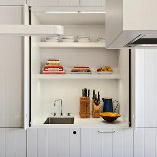 Kitchen - contemporary kitchen idea in Melbourne with white cabinets