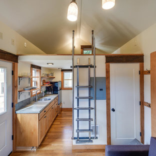 Small traditional galley eat-in kitchen in Portland with a drop-in sink, recessed-panel cabinets, medium wood cabinets, limestone benchtops, grey splashback, slate splashback, stainless steel appliances, medium hardwood floors, brown floor and grey benchtop.