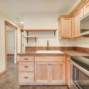Inspiration for a small traditional l-shaped open plan kitchen in Portland with a drop-in sink, recessed-panel cabinets, light wood cabinets, tile benchtops, orange splashback, cement tile splashback, stainless steel appliances, concrete floors, no island, grey floor and orange benchtop.