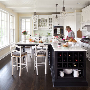 Mid-sized traditional open concept kitchen ideas - Mid-sized elegant l-shaped dark wood floor open concept kitchen photo in Minneapolis with white cabinets, an undermount sink, shaker cabinets, marble countertops, white backsplash, ceramic backsplash, stainless steel appliances and an island