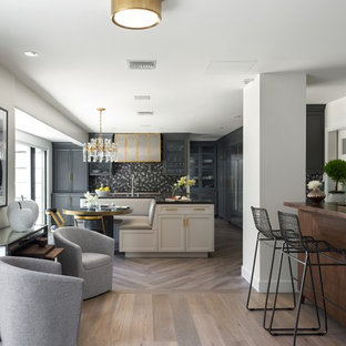 Design ideas for a large transitional single-wall eat-in kitchen in Los Angeles with recessed-panel cabinets, grey cabinets, with island, an undermount sink, multi-coloured splashback, porcelain splashback, panelled appliances, porcelain floors, brown floor and grey benchtop.