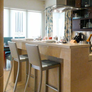 Design ideas for an eclectic eat-in kitchen in Miami with flat-panel cabinets, dark wood cabinets, concrete benchtops, metallic splashback, metal splashback, stainless steel appliances, marble floors and with island.