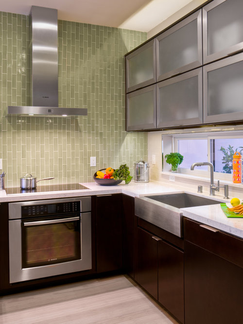 contemporary kitchen idea in san francisco with stainless steel appliances and a single bowl sink
