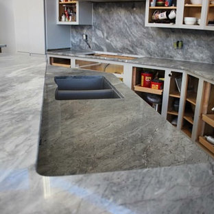 Large contemporary galley open plan kitchen in Grand Rapids with a double-bowl sink, open cabinets, grey cabinets, marble benchtops, grey splashback, marble splashback and with island.